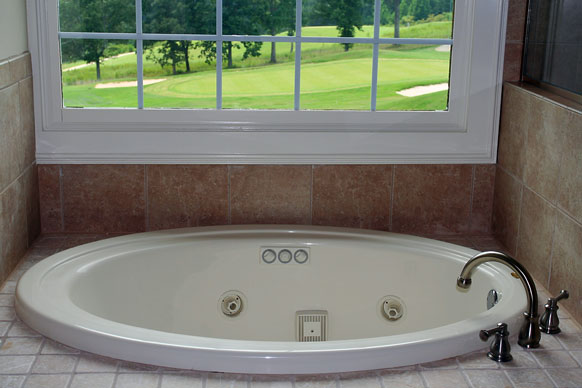built-in jetted tub near a window