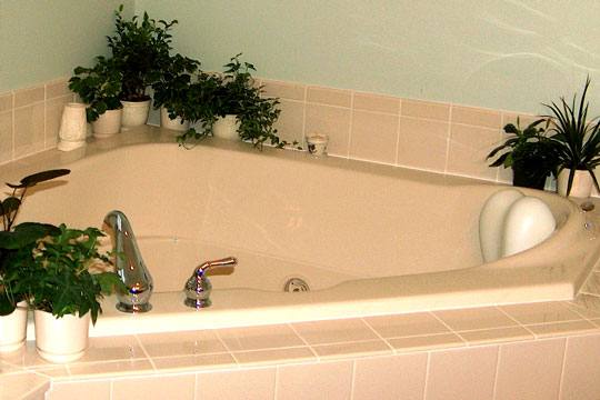 triangular whirlpool tub set in ceramic tile